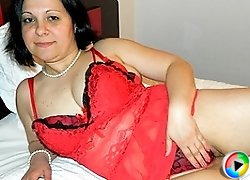 Naughty housewife playing with her pussy on her bed