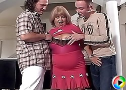 Fat grandma showing her big tits and getting double-team fucked by a couple of hot college boys
