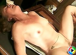 Slutty granny gives head to her lewd old boss and gets fucked right on his working desk