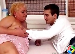 Hung boy fucks raunchy fat granny�s throat and drills her snatch from behind