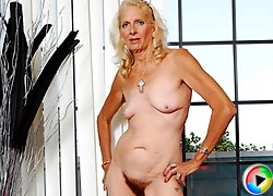 Granny gets it on with big dicked stud!