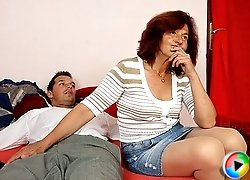 Sultry grandma puts her mouth on his cock and sucks him while he lies there and loves it