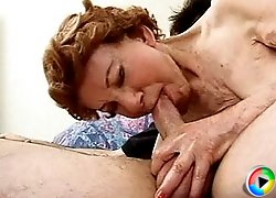 Old granny sucks off a younger cock