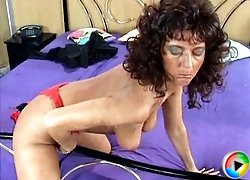 Mature in red lingerie plays